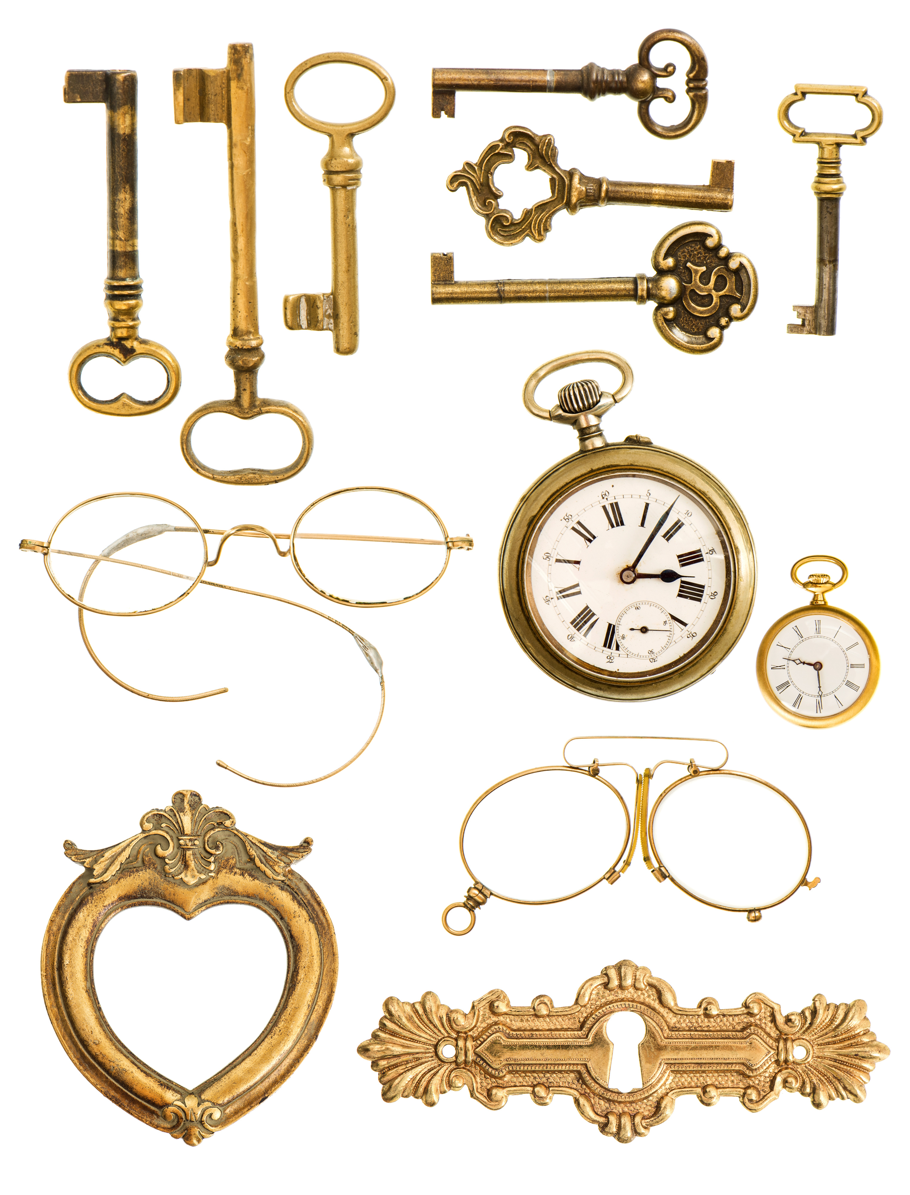 collection of golden vintage accessories. antique keys, clock, frame, glasses isolated on white background